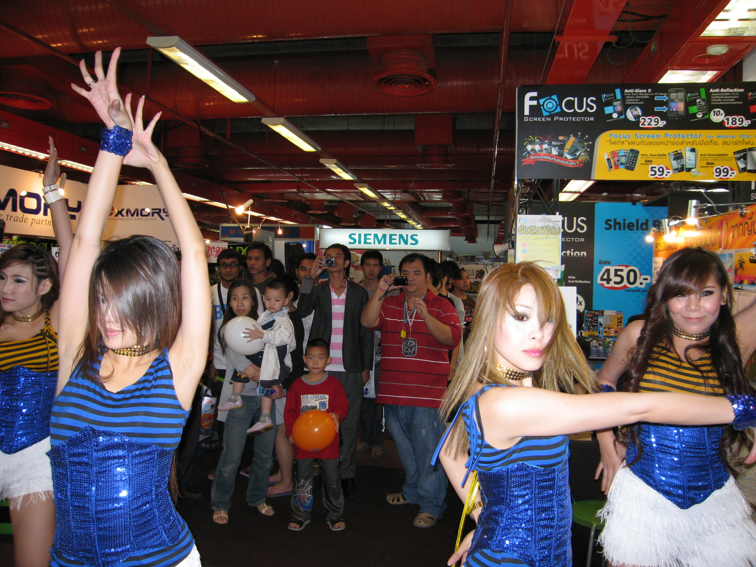Dancing girls at computer fair