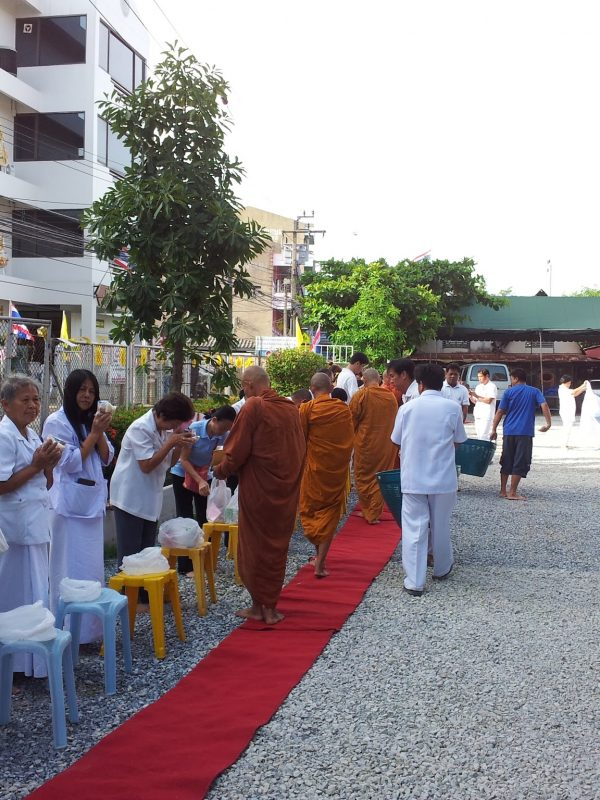 Making an offering to monks in the morning on Magha Puja Day