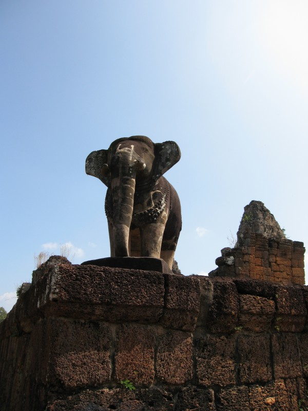 Huge elephant statues guarding the corners of the ancient Khmer temple of East Mebon